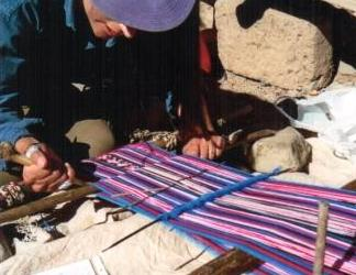 Weaving on the staked-out ground loom in Potosi