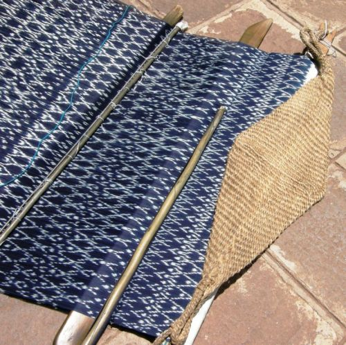 "The simple backstrap loom of Tacabamba, Peru on which the indigo ikat-patterned ""panones"" are woven. They are up to one-meter wide, covered with tiny motifs and have patterns knotted into their fringes."