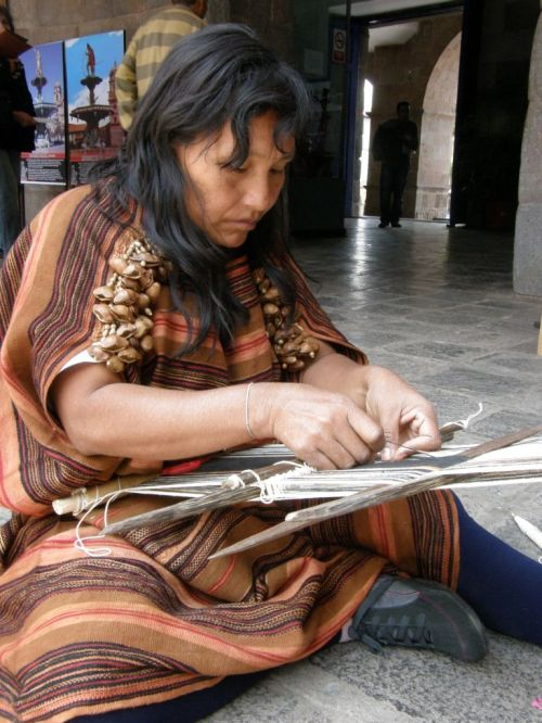 A Matsigenka weaver from tropical lowland Peru creates warp-float patterns in cotton on her backstrap loom.