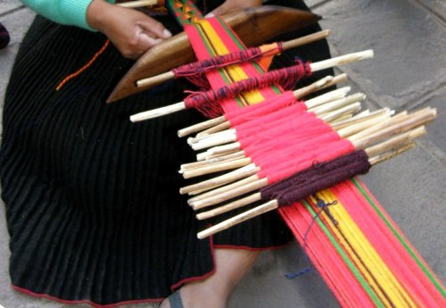 "Twenty-four heddle sticks are used to weave the traditional pattern on the ""faja sara"" of San Ignacio de Loyola."