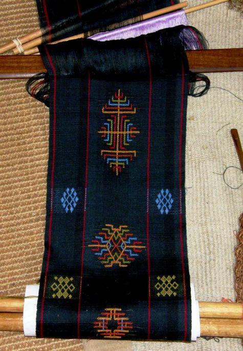 The center of Bhutan scarf project bacckstrap loom