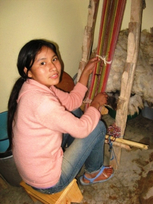 Gabriela Zenteno is 16 and has been part of the Handcraft Club since it began in 2010. She learned to weave from maxima with additonal help from her mother. Because the family lives in town instead of on the farn and Gaby goes to school, she did not learn to spin and weave at her mother's side which is integrated into the ancient farmer subsistence lifestyle.