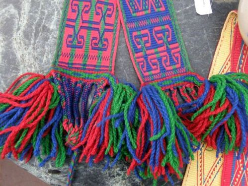 braiding and weft twining at bottom of siira belts