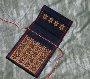 design on inside flap backstrap woven pouch