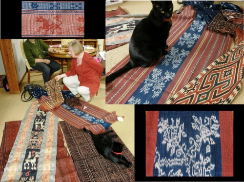 Judith lays out the textiles under the supervision of Trouble the cat.