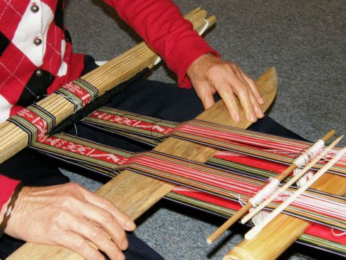 montagnard weavers with two bands on loom