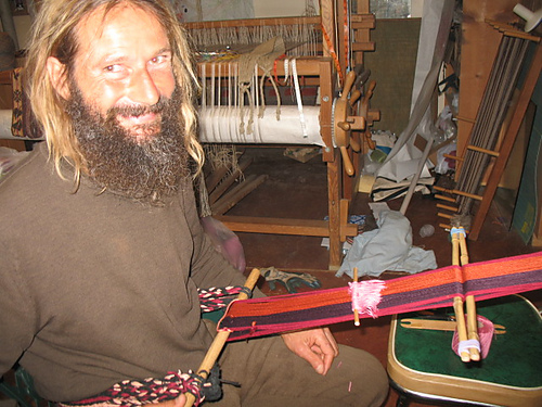 Erik backstrap weaving at Janet's