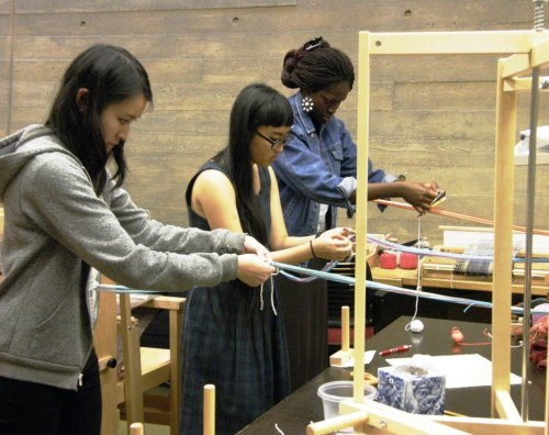 Backstrap weaving with students at Yale University.... They have a wonderful weaving room full of floor, table and rigid heddle looms which meant standing room only for this impromptu lesson in basic backstrap loom management which followed my talk.