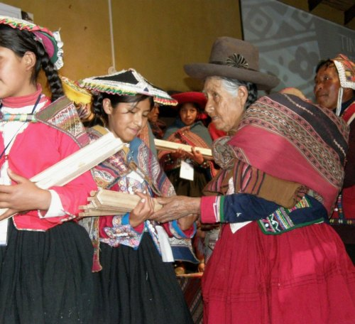 A community elder gives a set of tools toa young weaver at a ceremony at the Tinkuy de Tejedores in Urubamba 2010.