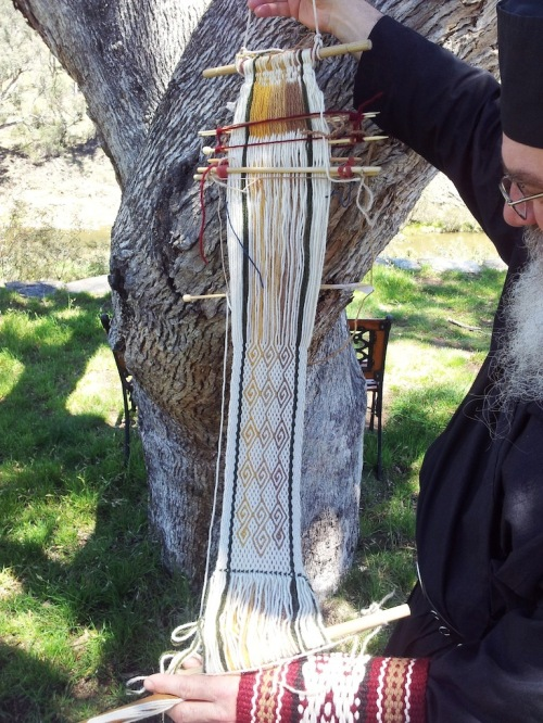 Fr. Kyriakos with one of his projects. He has been learning to weave on a backstrap loom using my blog and books. Now he needs to make a forked stick for himself!