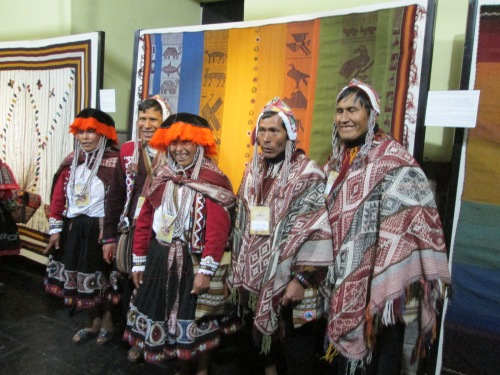 Dorinda's photo shows proud weavers from Chahuaytire at Tinkuy 2013 standing on front of their entry in the 2013 community weaving competition.