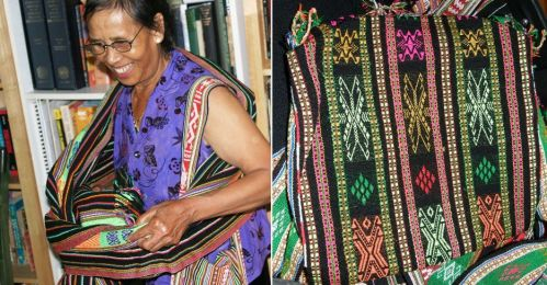 My Vietnamese weaving tecaher Ju Nie showed us how she wraps a baby sling. The Montagnard baby slings are woven on backstrap looms and often decorated with motifs in supplementary weft. made