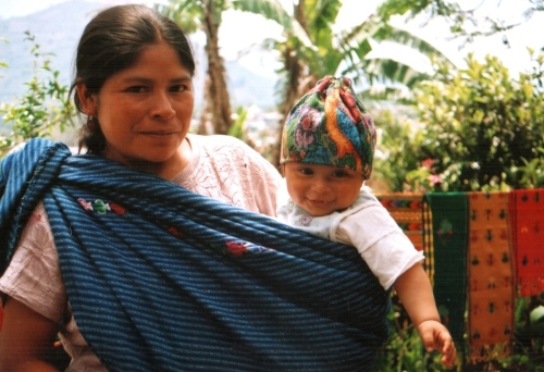 One of my weaving teachers in Guatemala shows me her nephew which she carries in a woven sling. His little cap is a woven piece which has been decorated with a double faced supplementary-weft technique. Therectabgle of fabric has a draw string through the top which is pulled to the form the cap.