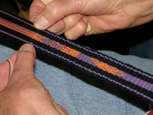 """Barbara's challenge involved weaving her favorite """"viscacha"""" motif in fine thread (Aunt Lydia's #10) and swapping the colors for the motif and background while creating beautifully straight edges."""