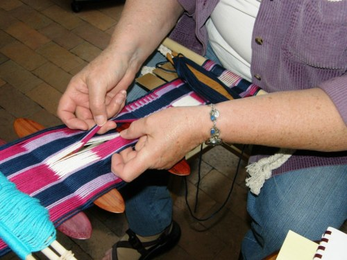 Jane uses a mulitple sword technique to pick up a pattern for her backstrap project.