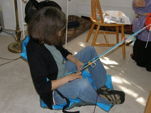 Lynn at home on floor backstrap weaving