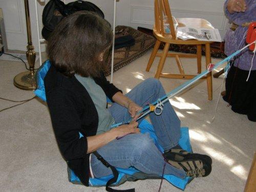 Lynn at home on floor backstrap weaving