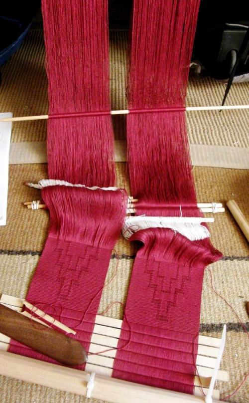 red on red panels on backstrap loom
