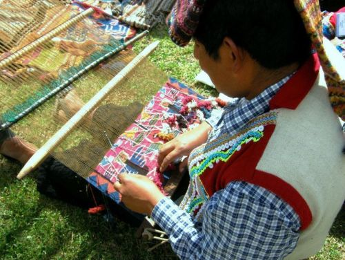 A weaver from Pitumarca  taht I watched at Tinkuy 2010 creating a taspestry using a backstrap loom.