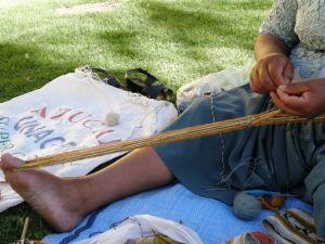 Maxima, Cochabamba, Bolivia making heddles.