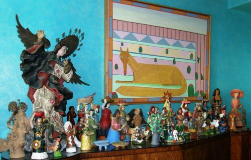 A forest of figurines...part of Gay's husband's collection of folk art.