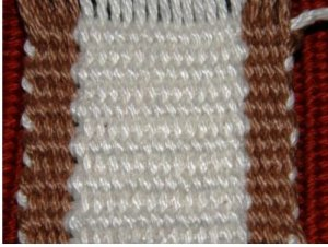 Using a weft color that contrasts witthe color fo the edge warps can help you see better what is going on there.