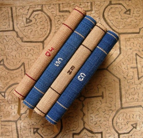 initials woven into spine of journals