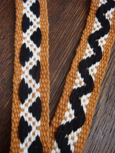Half-basket weave ground weave with patterns created with black supplemental warp threads...by Julia