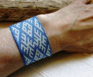 wrist cuff in silk backstrap weaving