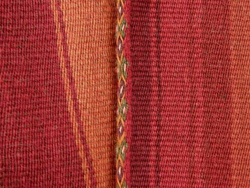Cloth from Chahuaytire, Peru edged with a tubular band in beautiful natural dye colors