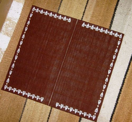 two brown panels backsrap weaving