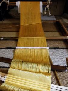 yellow silk warp backstrap weaving