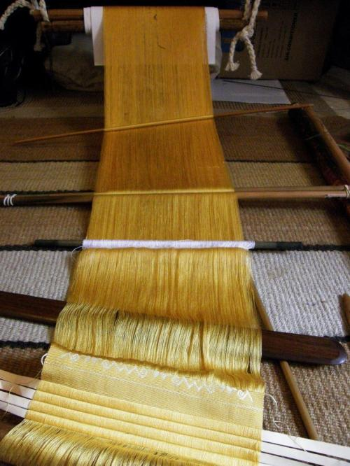 yellow silk warp backstrap weaving