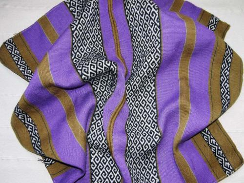 purple blanket waiting for edging backstrap weaving