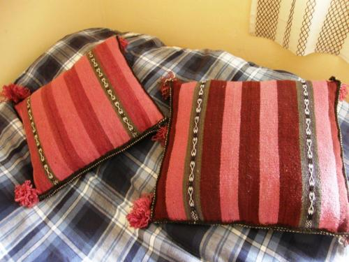 woven pillows with handsun wool and natural dyes colors