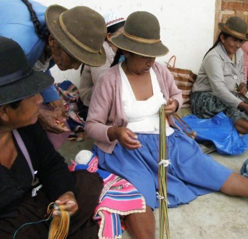 examining a woven sample to copy