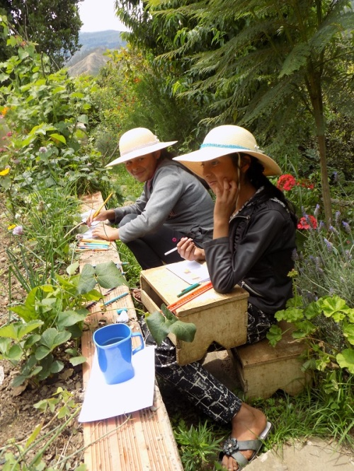 Vero and Abi drawing their Thank You cards in Dorinda's lovely garden